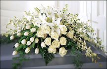 The FTD Ressurection Casket Spray from Clifford's where roses are our specialty