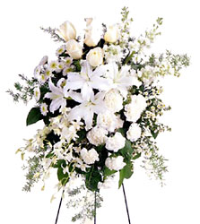 FTD Quiet Tribute Standing Spray from Clifford's where roses are our specialty