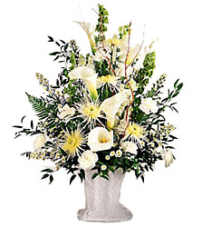 Solemn Offering Arrangement from Clifford's where roses are our specialty