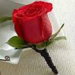 Red Boutonniere from Clifford's where roses are our specialty