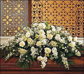 Pure White Casket Spray from Clifford's where roses are our specialty