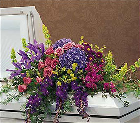 Graceful Tribute Casket Spray from Clifford's where roses are our specialty