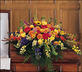 Celebration of Life Casket Spray from Clifford's where roses are our specialty
